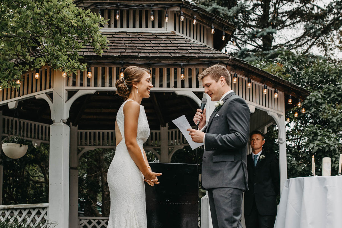 bride-and-groom-exchanging-vows-wedding-ceremony-ruffled-feathers-golf-club-lemont-il-adventurous-wedding-photographer