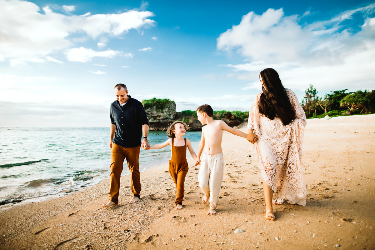 Okinawa Family Photographer, Family walking together holding hands on the beach