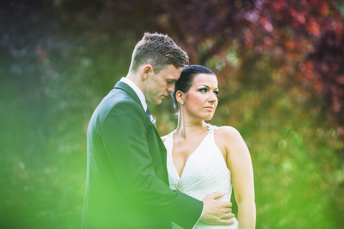 bride and groom portrait at combermere abbey. low cut wedding dress