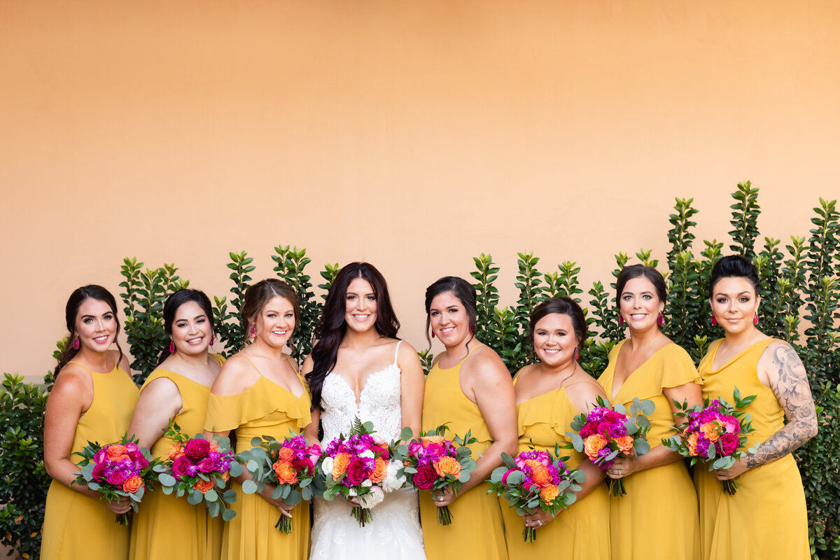 Bridal party portrait with bright yellow dresses and bold floral