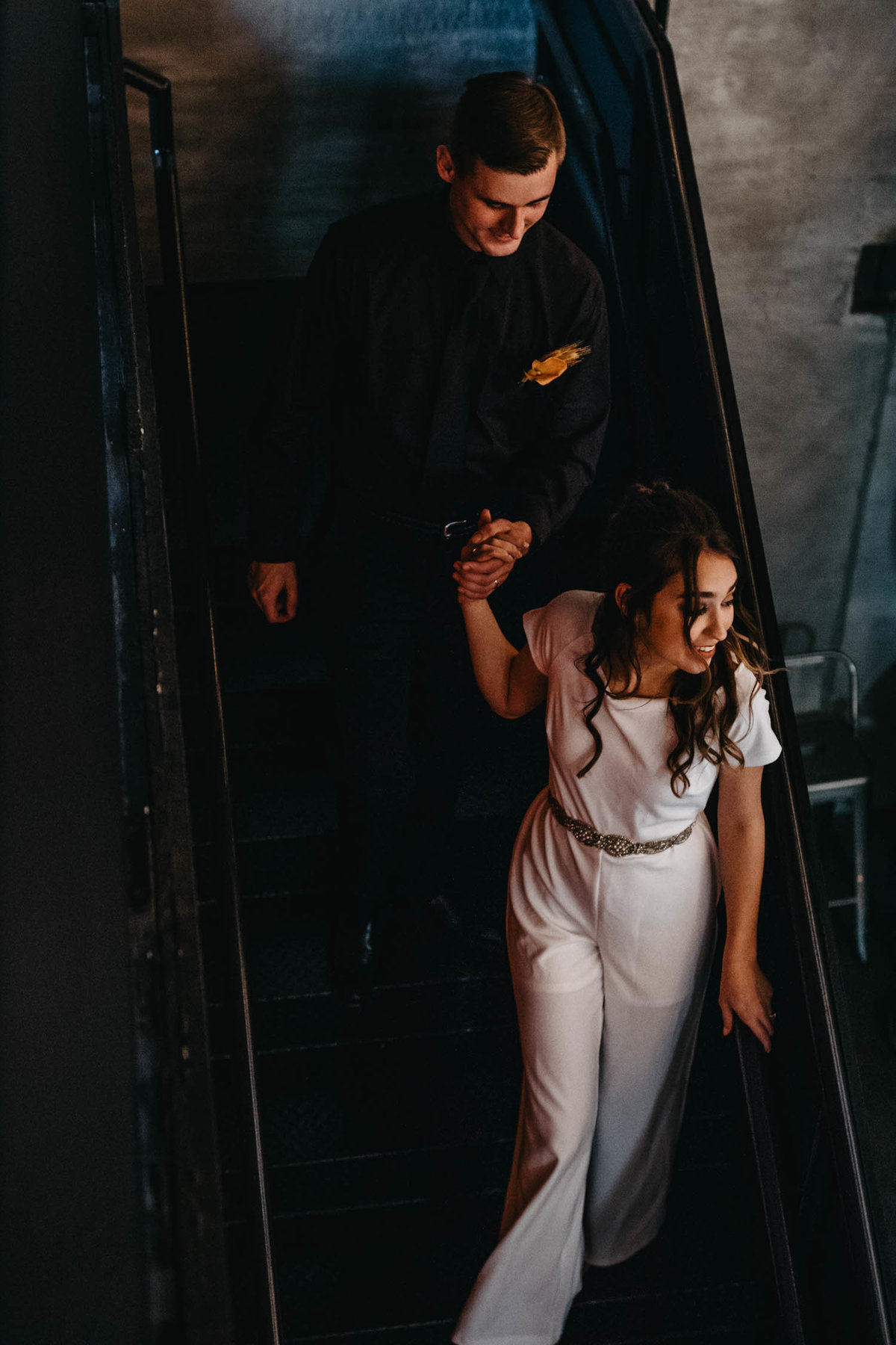 wedding-day-couple-on-staircase-brewery-elopement-6