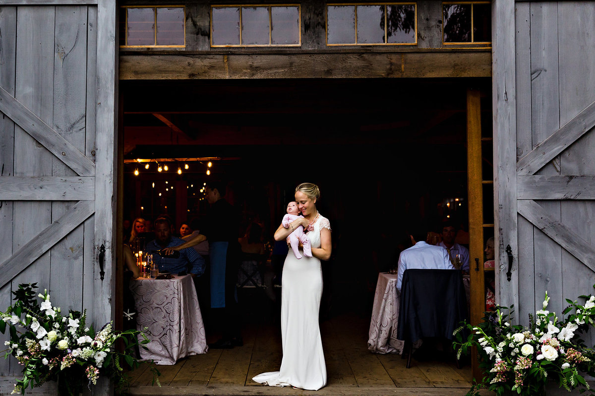 Primo Restaurant Wedding where the bride snuggles close to her newborn daughter