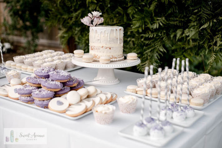 white and purple sweets table