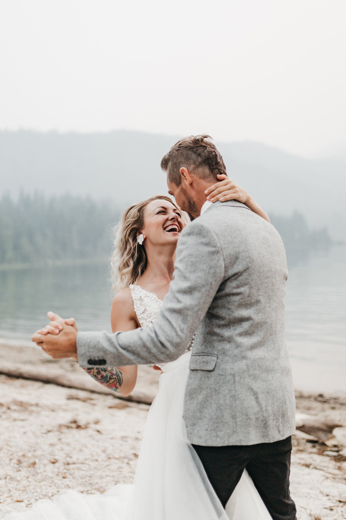athena-and-camron-sara-truvelle-bridal-wenatchee-elopement-intimate-11-laugh-first-dance