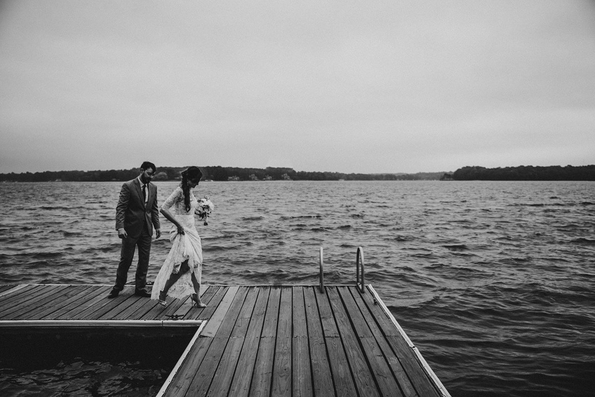 Wedding couple walking on a dock in North Carolina