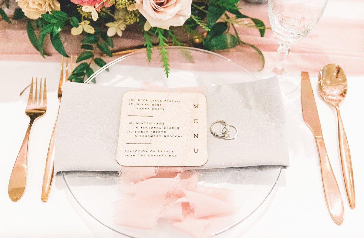Place settings and wedding invitations
