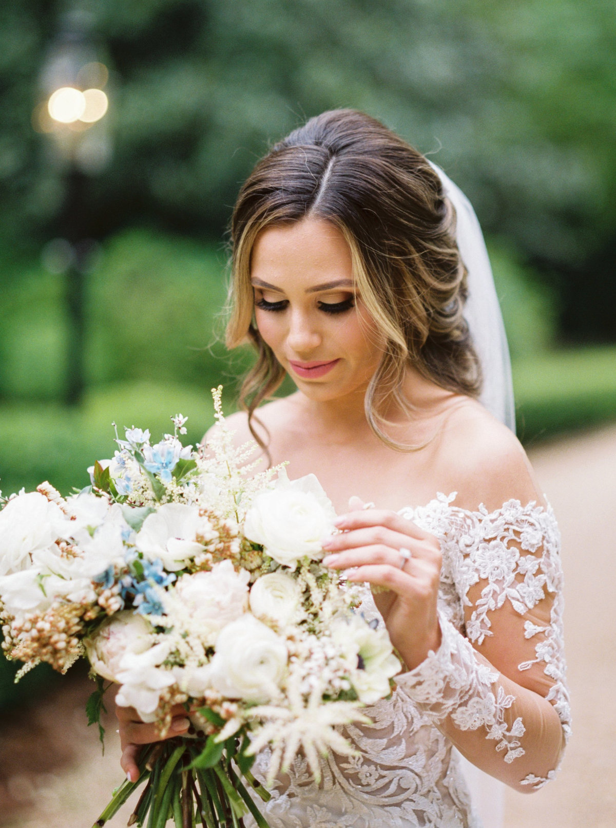 Bride with neutral bouquet and long sleeve gown
