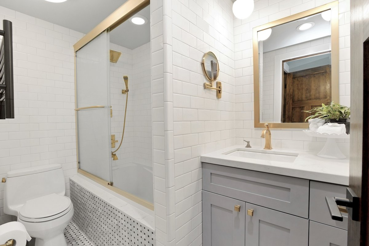 Master bathroom with shower, soaking tub, heated towel rack, and magnification mirror