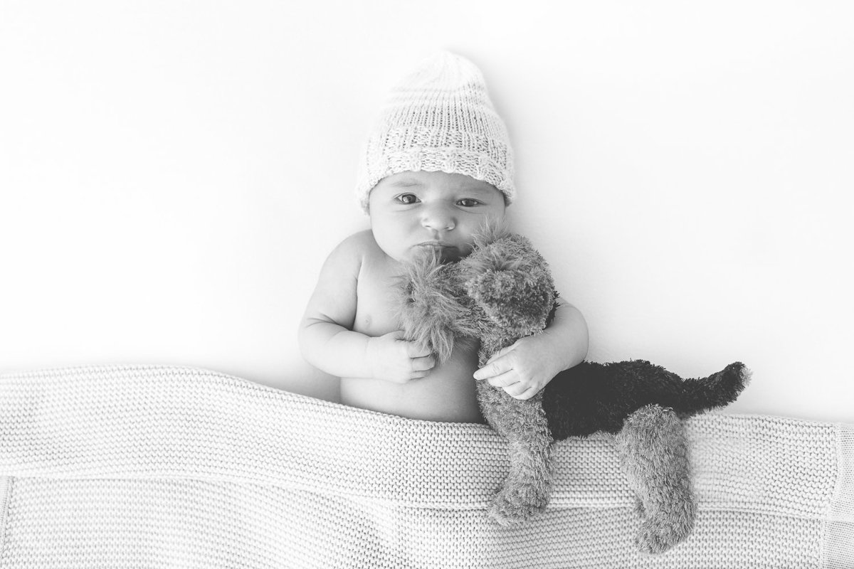 baby boy awake hugging dog stuffy {Etobicoke Newborn Photographer}