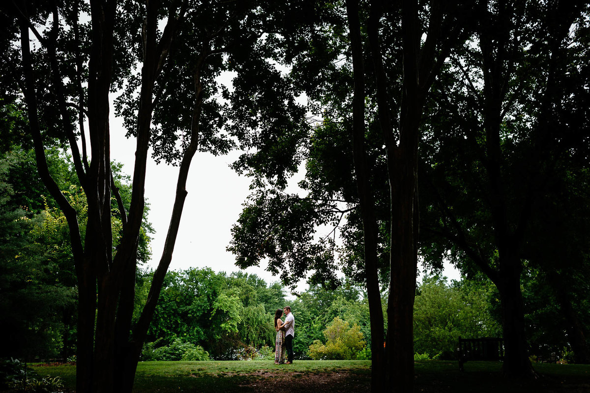 couple walking at dallas arboretum during their dallas engagement session