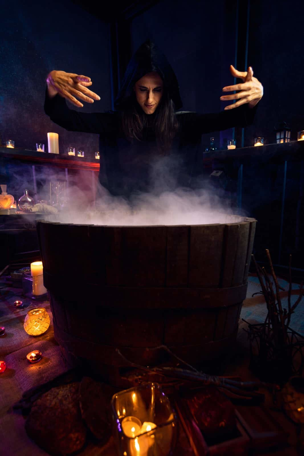 atlanta witch brewing potion over cauldron