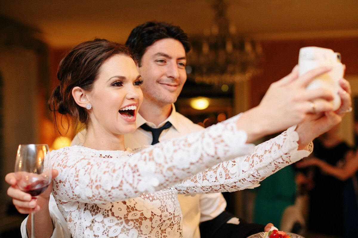 woman and man taking selfie at Italy wedding reception