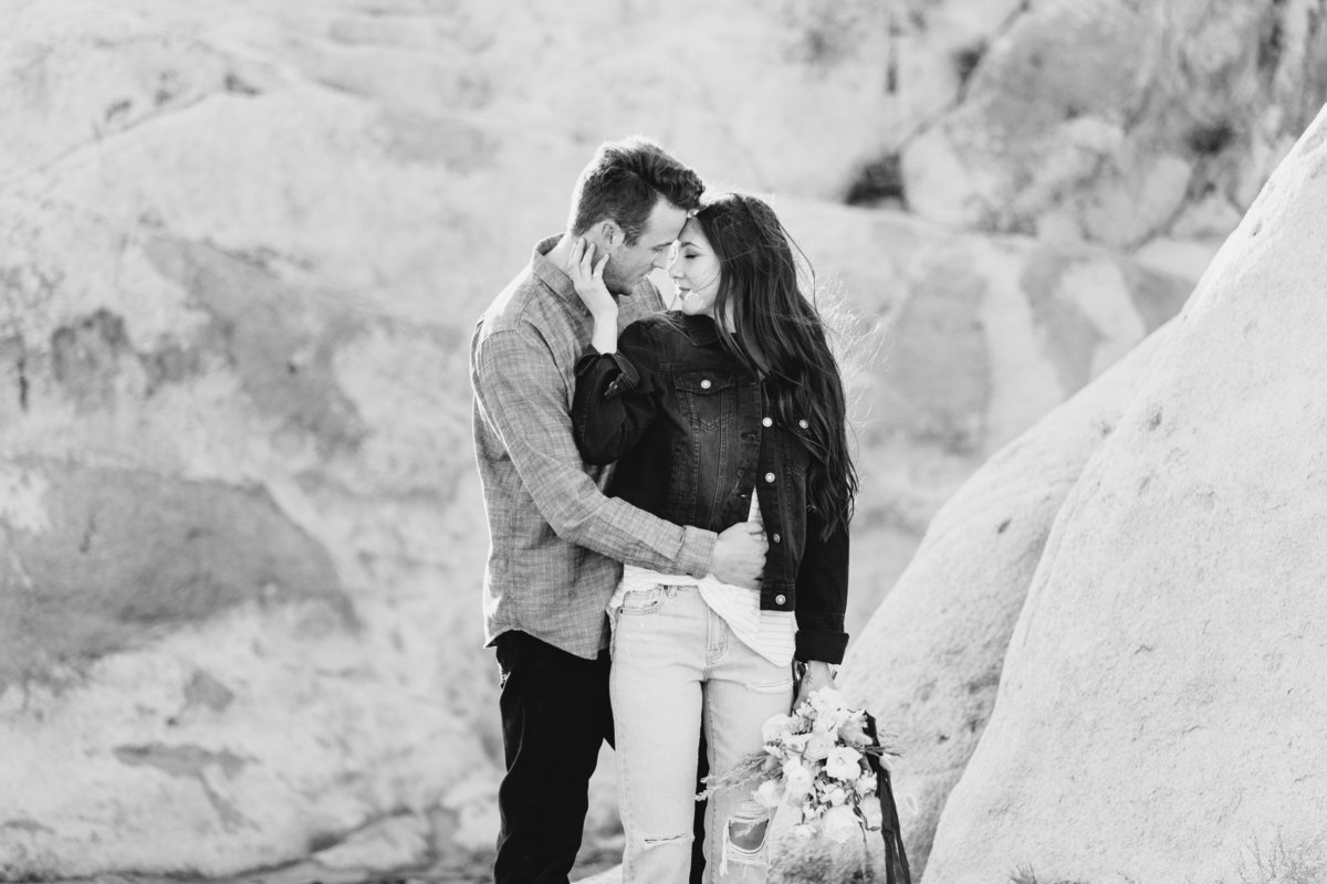 Reno engagement photographers couple embraces at Moon Rock in Reno