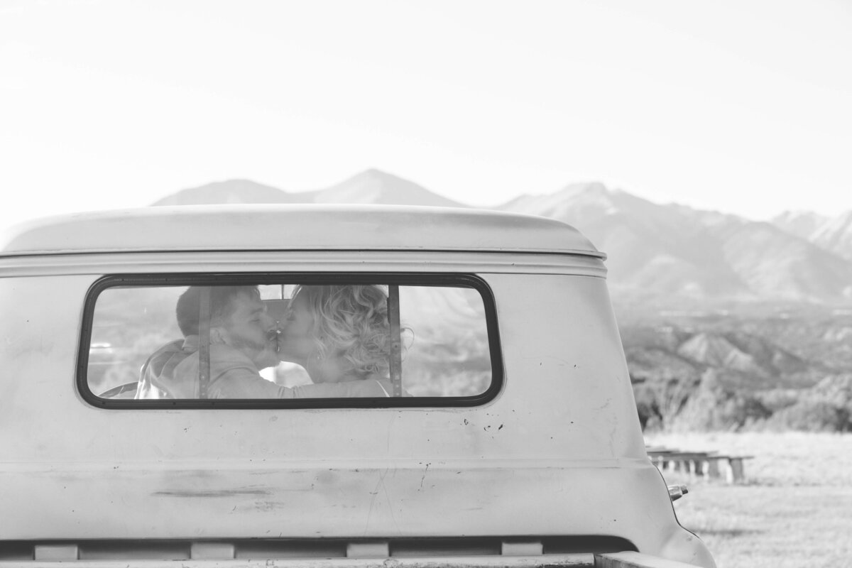 BrideandGroomKissingInOldTruck