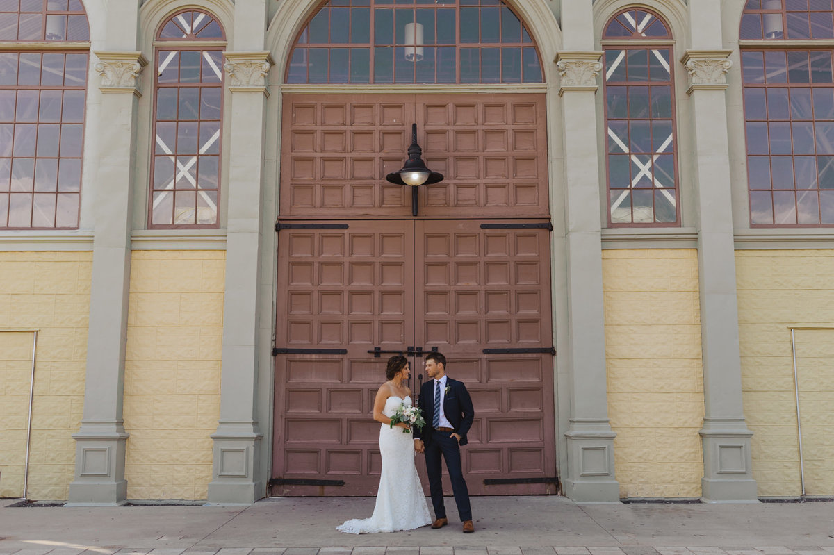 bride and groom standing in front of the Aberdeen pavilion building