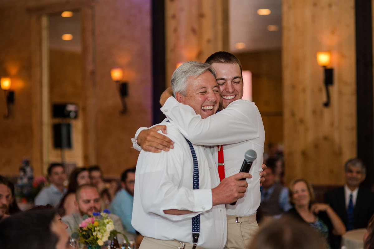 moment between son and father wedding day