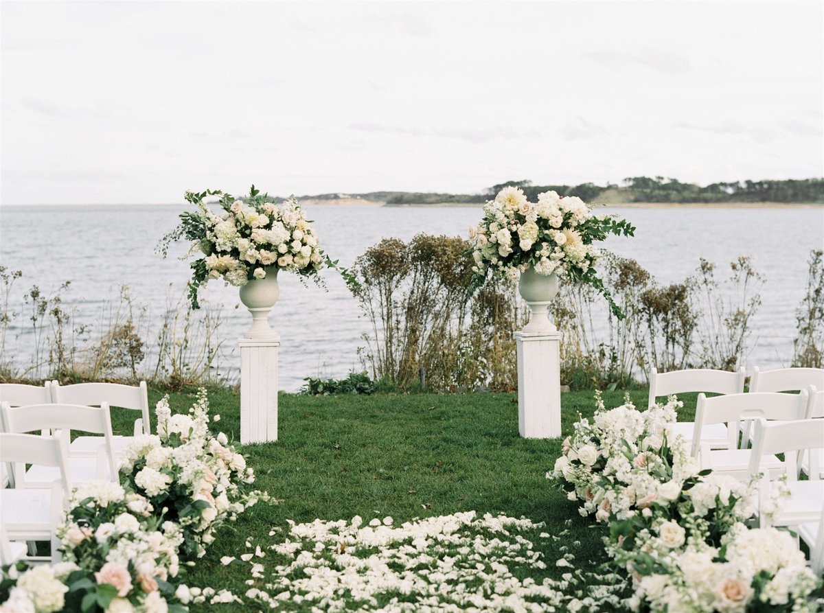 coastal wedding ceremony with flower urns for a Cape Cod Wedding by luxury Cape Cod wedding planner and designer Always Yours Events