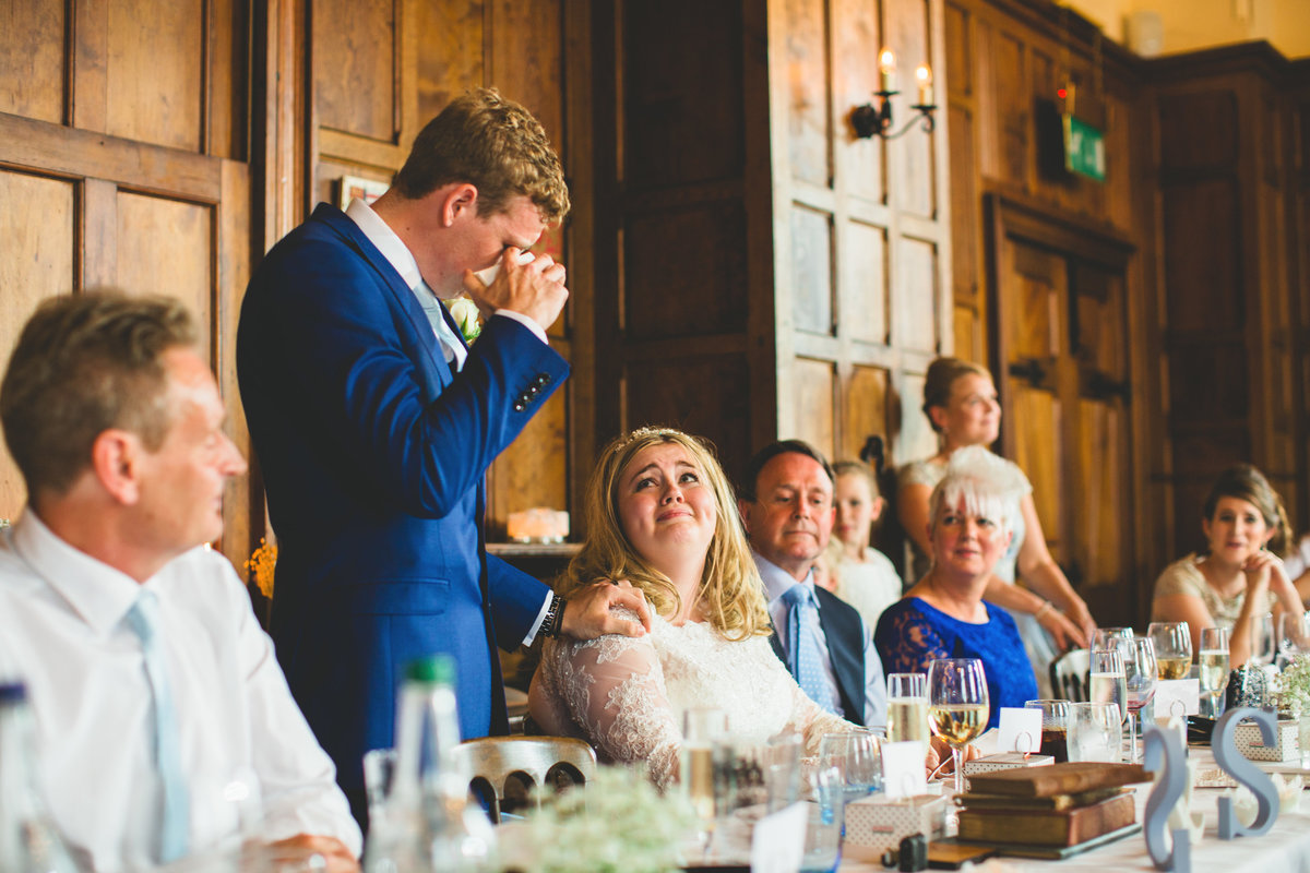 the groom is emotional and crying during his wedding speech