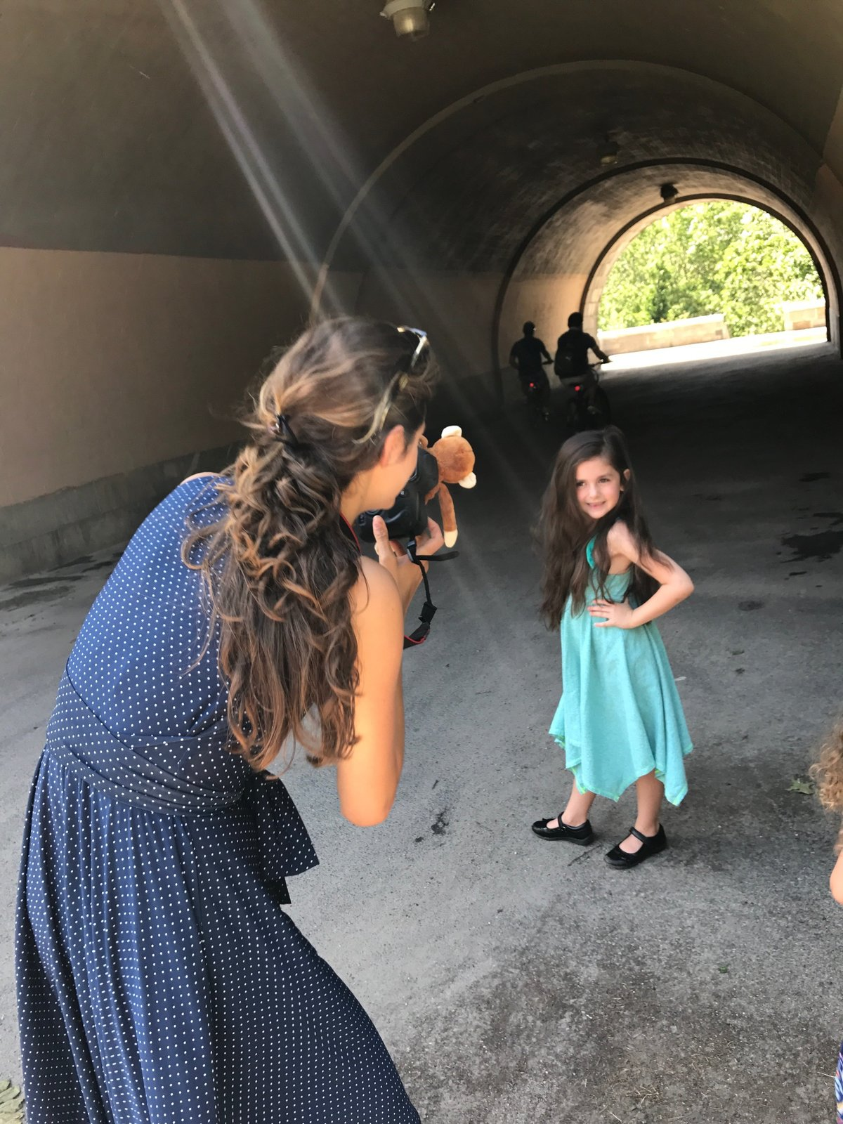Laura Volpacchio takes headshots for adorable five year old girl in Riverside Park NYC
