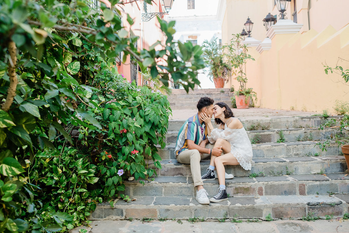 couple sitting on grey staircase