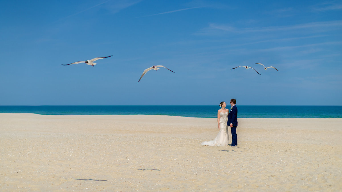 Bride and groom at the beach during their jersey shore wedding