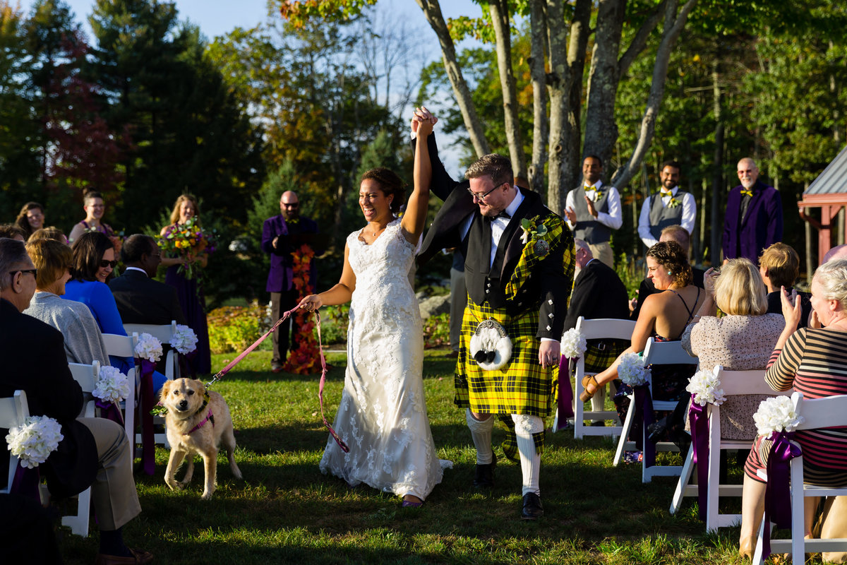 The bride and groom come back up the aisle after their ceremony in celebration at William Allen Farm in Maine