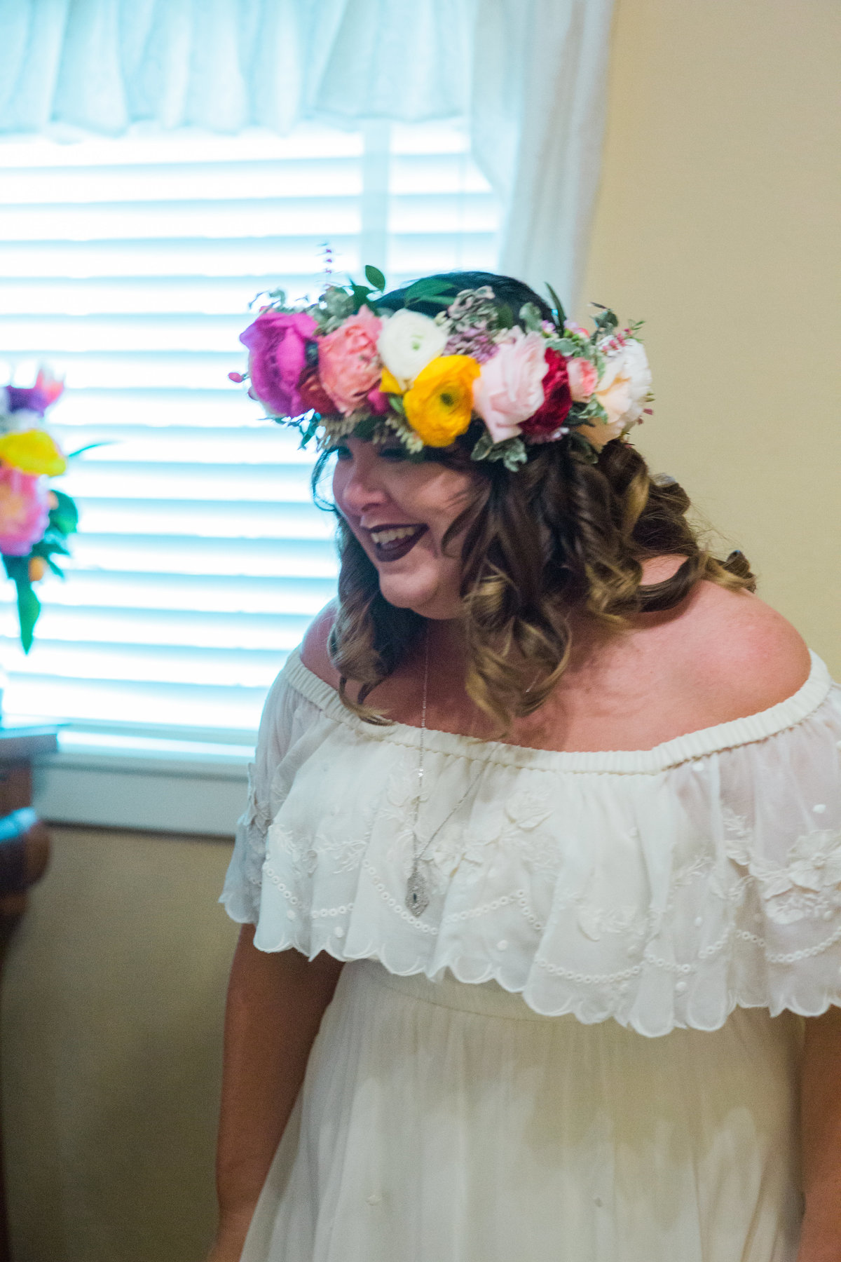 Bride excited about her floral crown at Madrona Manor in Healdsburg California