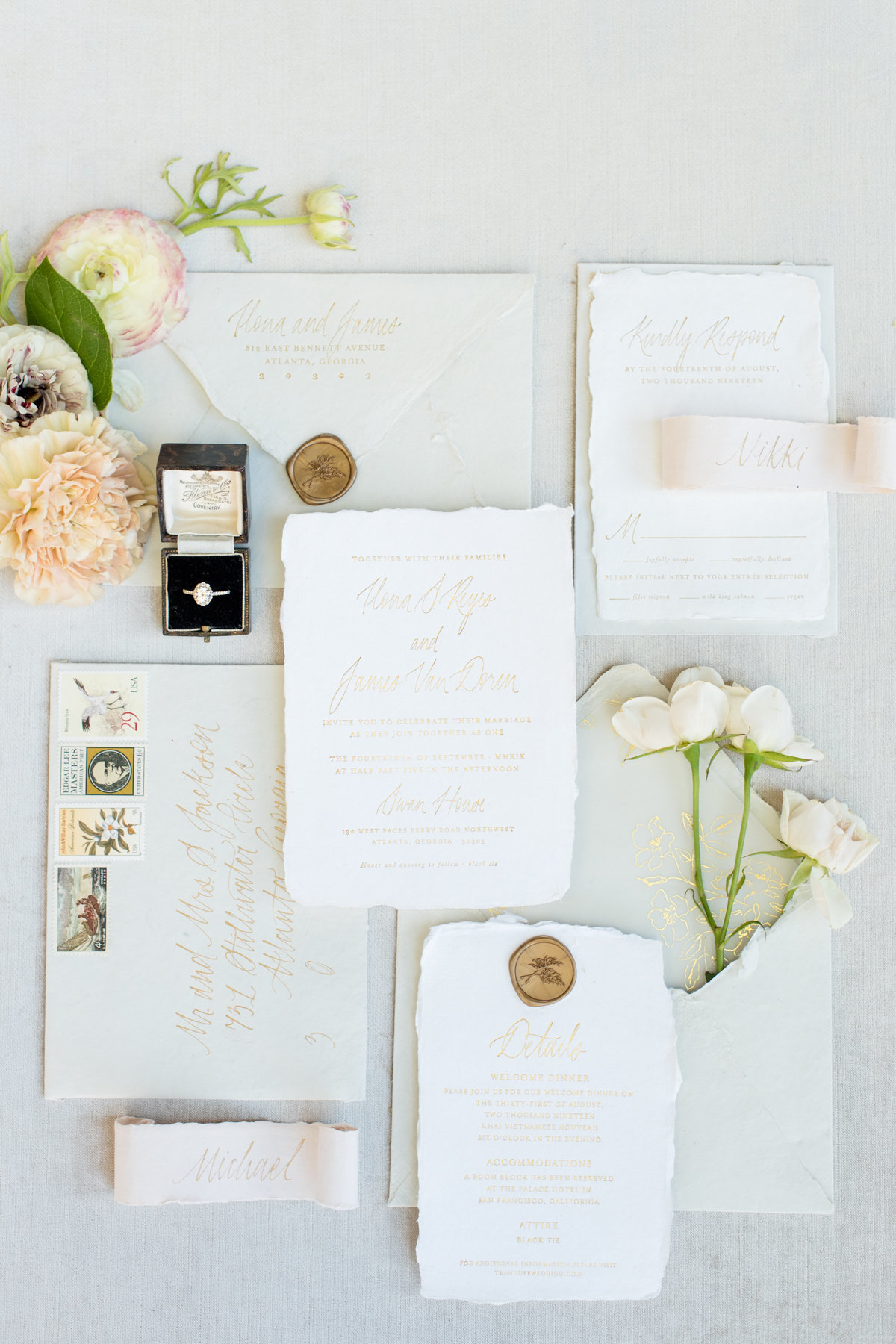 A fine art invitation suite by Ink and Press Co styled with flowers and a vintage ring box