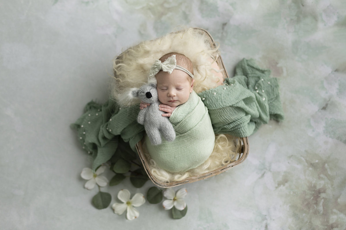 columbus-ohio-newborn-photographer-baby-girl-in-soft-sage-and-cream-wrapped-swaddled-in-prop-amanda-estep-photography