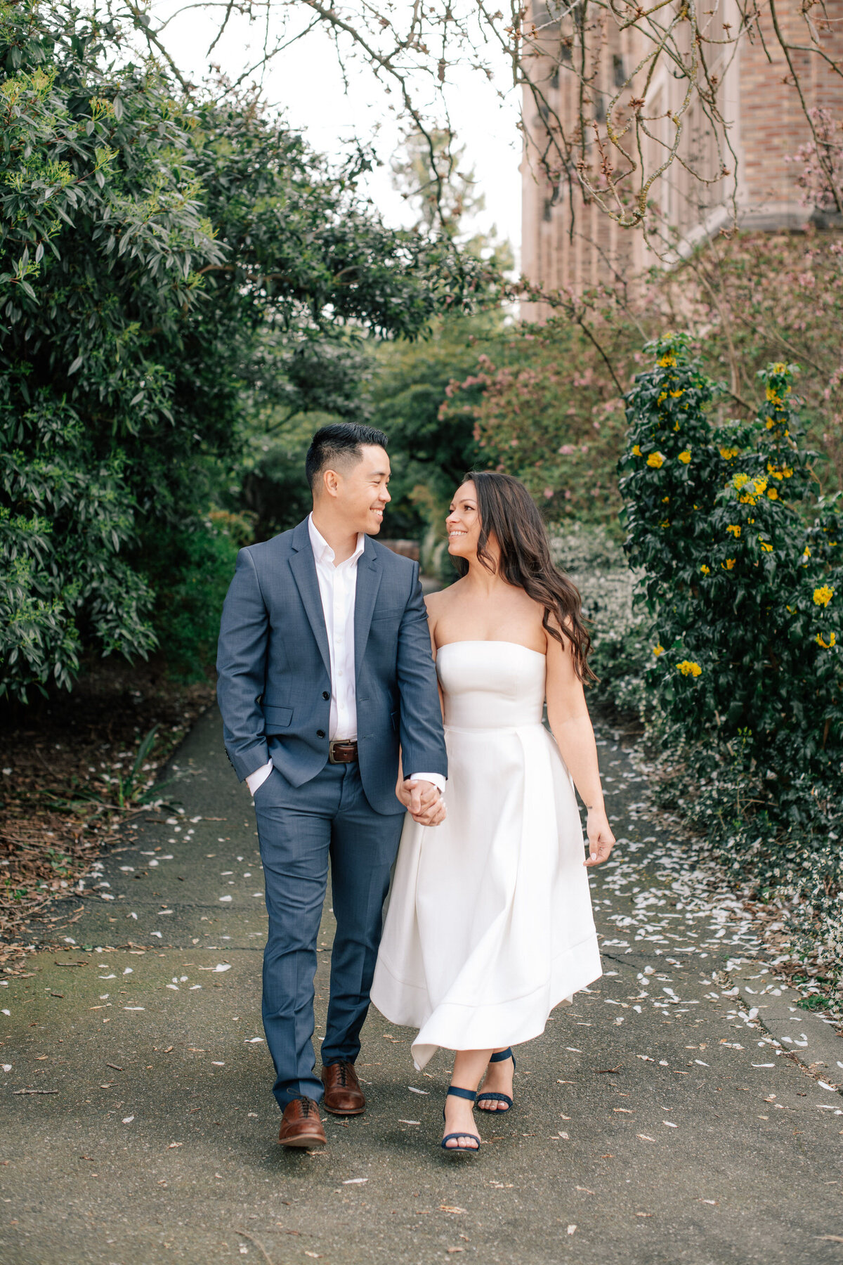 Couple walking on UW campus during spring engagement