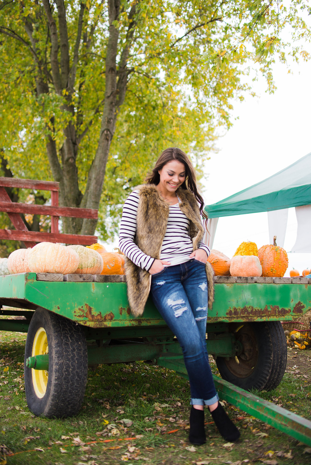 Senior Session Girl with Pumpkin Wagon