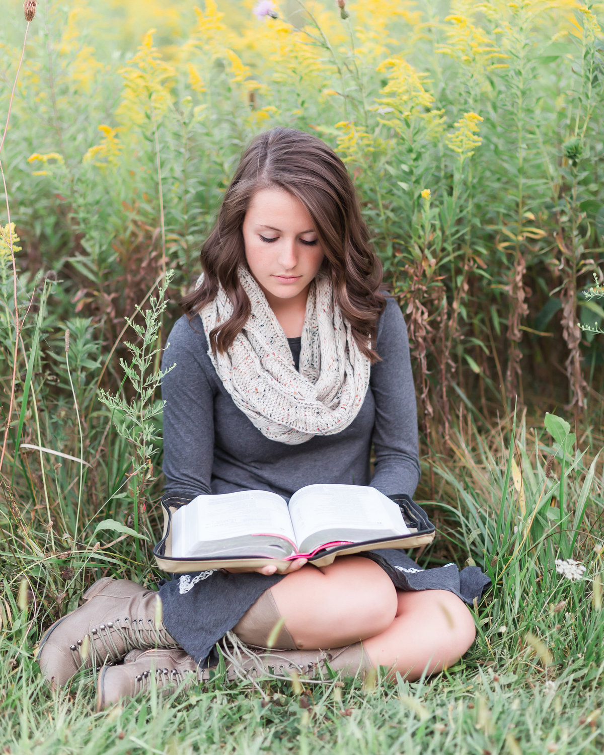 Senior girl-reading in field of wildflowers-gray yellow white