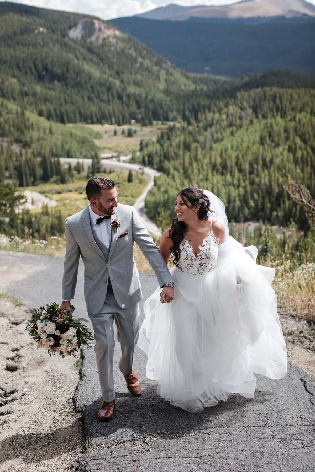 Couple walks up a small paved road in the mountains of Breckenridge Colorado
