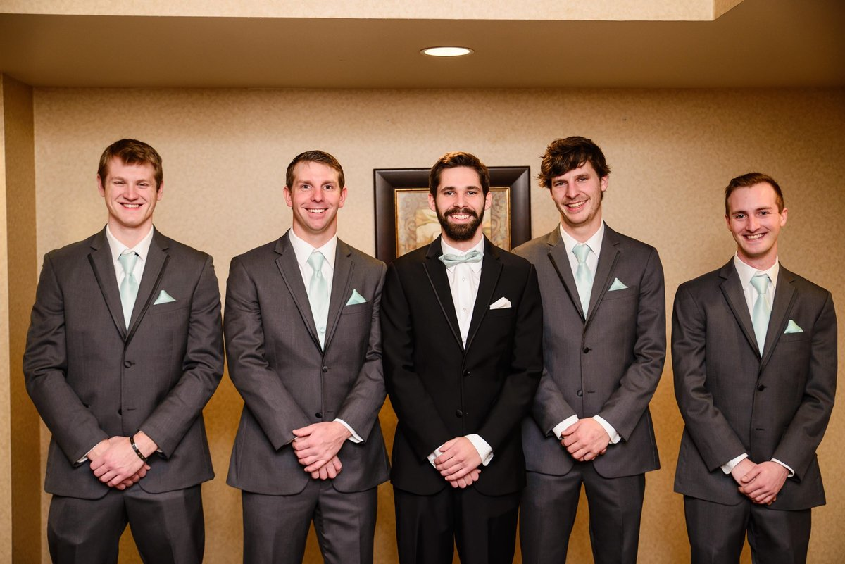 Grooms and Groomsmen getting ready during a winter wedding in Missouir