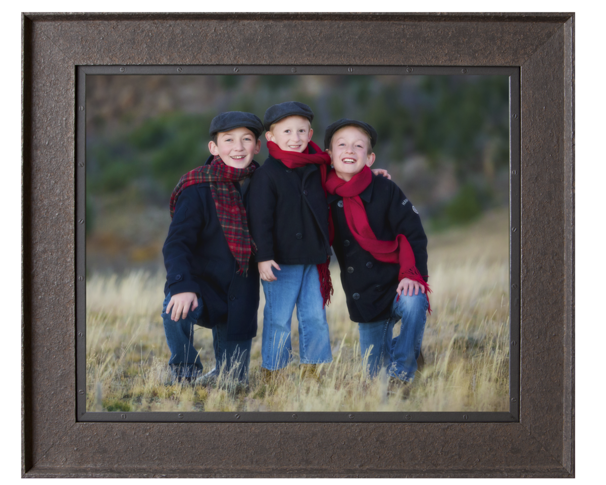 Boys dressed in navy with red scarfs in the Vedauwoo mountains.