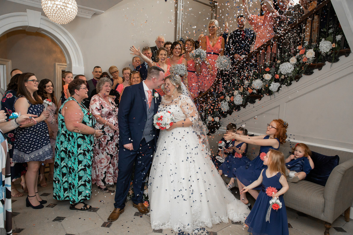 Confetti on stairs at Rockbeare Manor wedding Exeter_