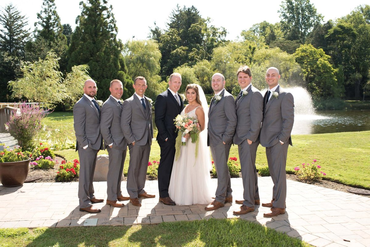 Bride and groom with groomsmen outside at Flowerfield