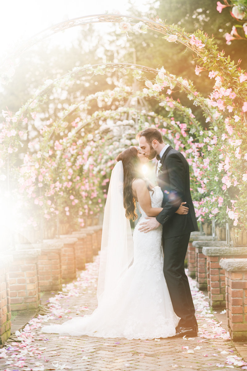 romantic floral sunset summer kiss dramatic wedding photography embrace bright airy