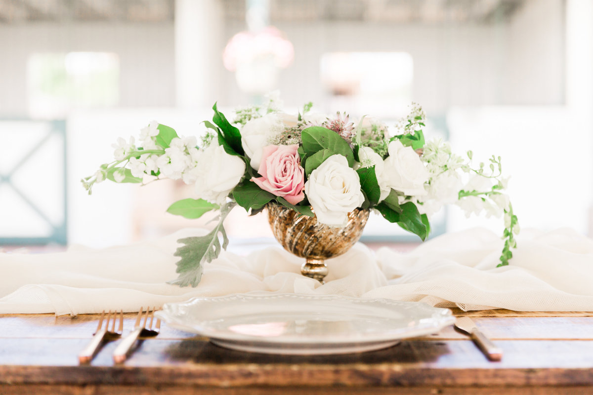 a floral centerpiece atop a rustic wood table in Las Vegas
