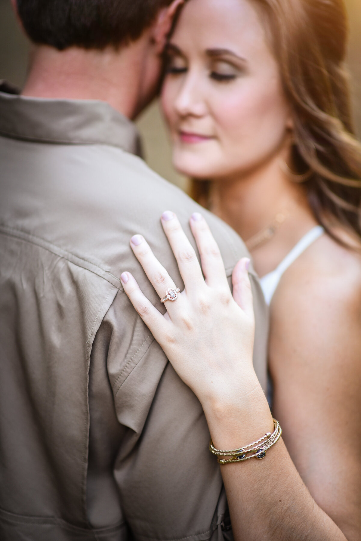 Beautiful Mississippi Engagement Photography: Bride shows off ring holding onto fiance's arm in MS Delta Pecan Orchard
