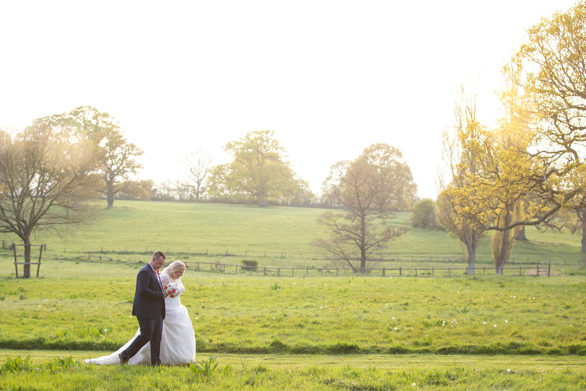 Wedding photo of couple in grounds of Rockbeare Manor Devon_
