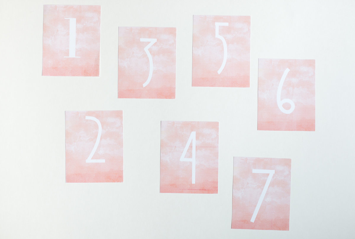 Ombre pink table numbers for weddings or events rental through Hue + FA Rentals