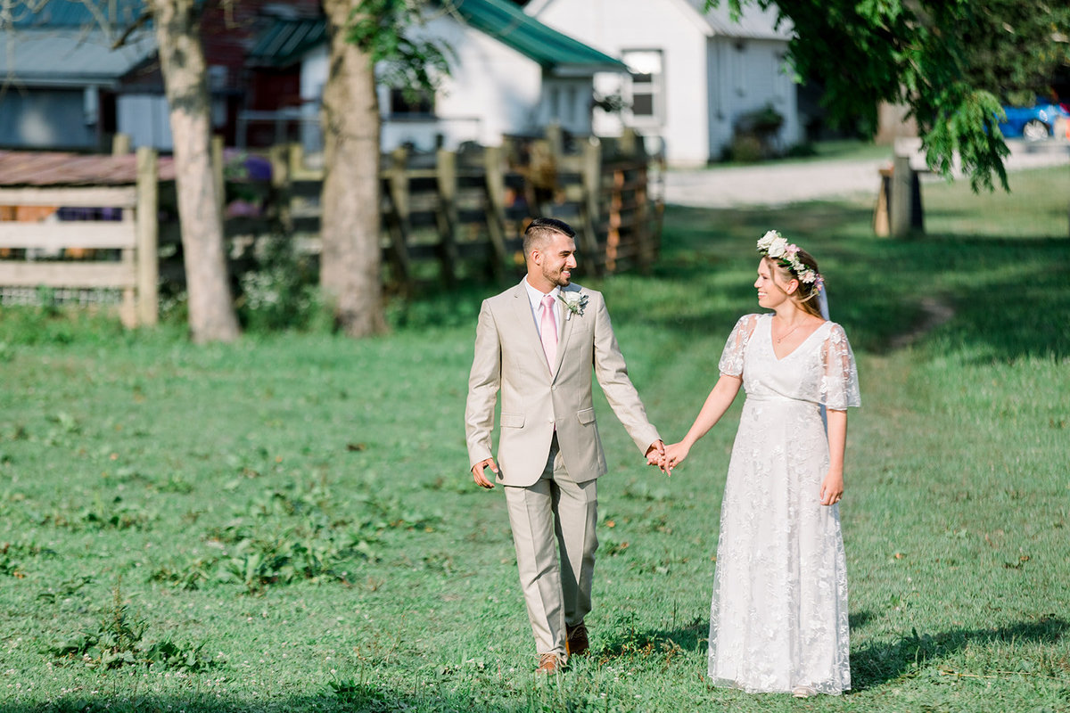 bride and groom walking on farm