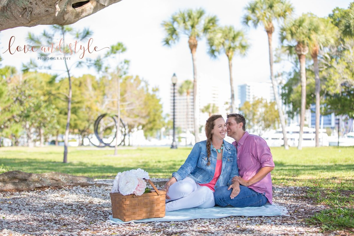 Sarasota Engagement Photography of couple having a picnic  under a tree at  Bayfront Park