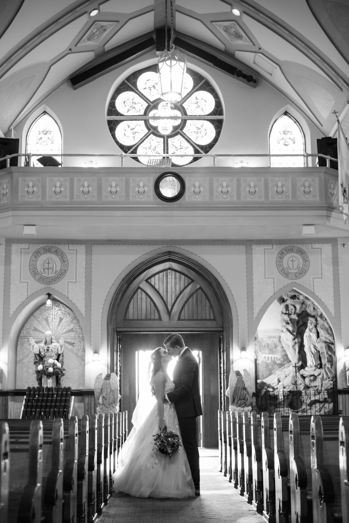 bride and groom kissing after church ceremony at saint catharines church