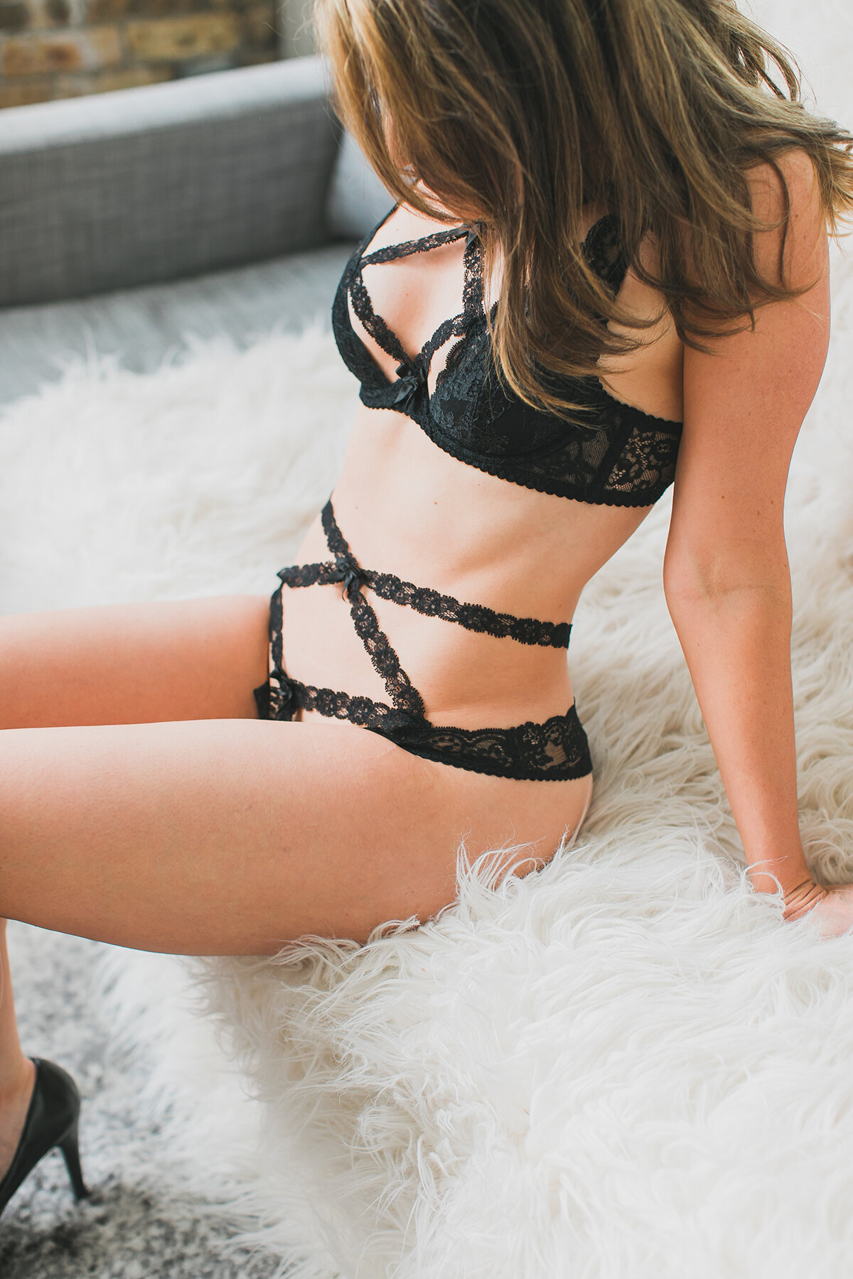 A boudoir photo of a woman wearing Agent Provocateur lingerie