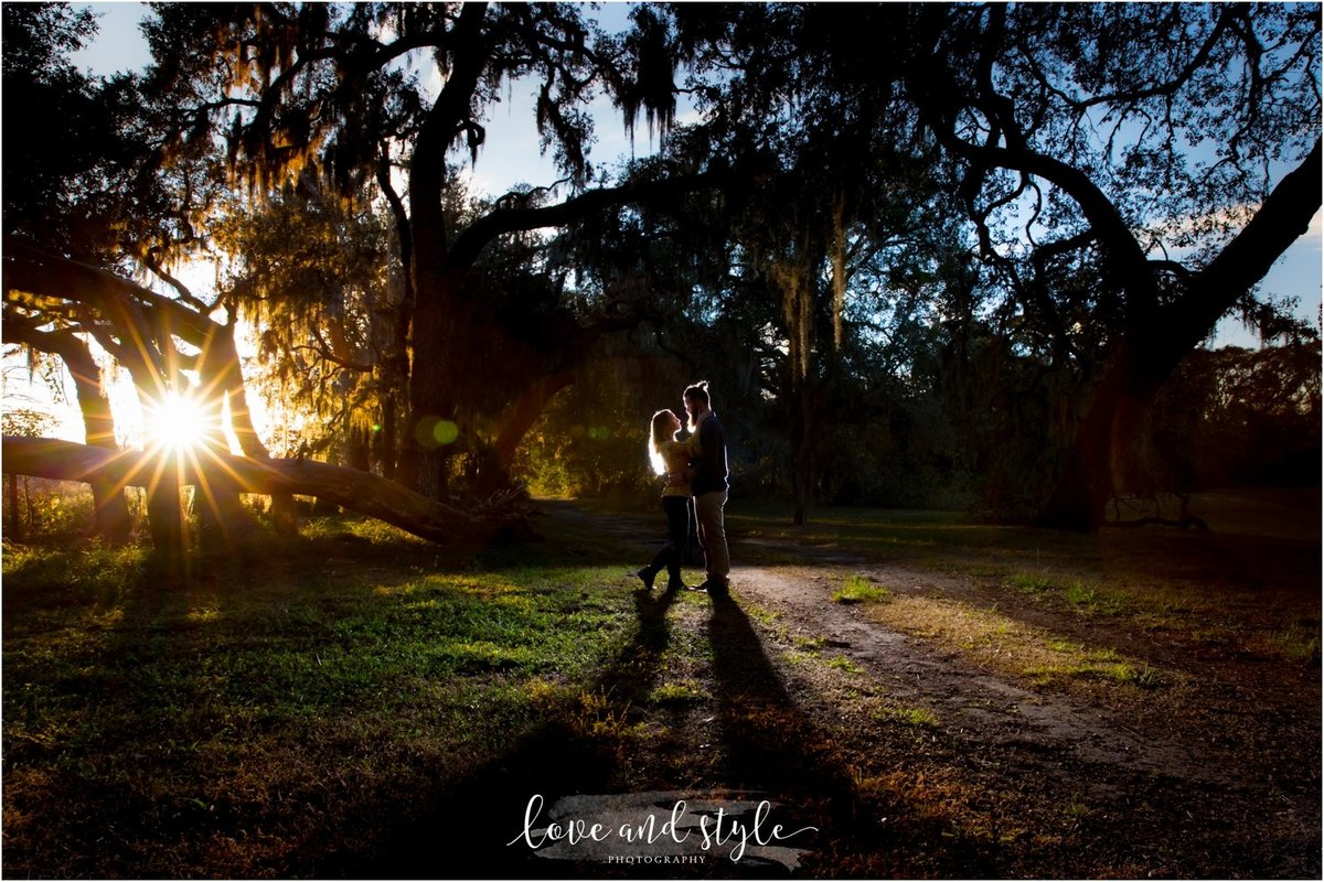Sarasota-Bradenton Engagement Photography of couple kissing  in the park with backlighting