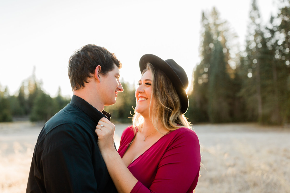 engaged couple smiling during a sunrise engagement session