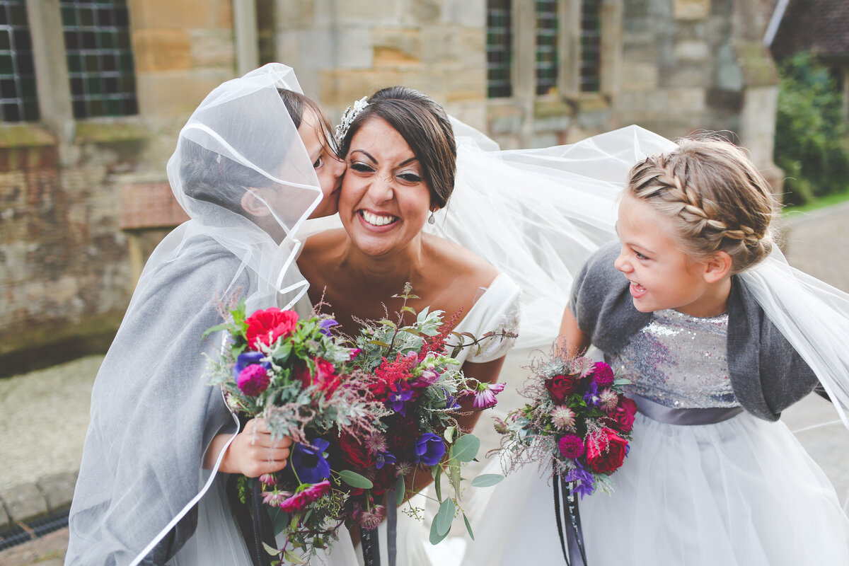 WP-BRIDE-WITH-FLOWER-GIRLS-KISSING_0011