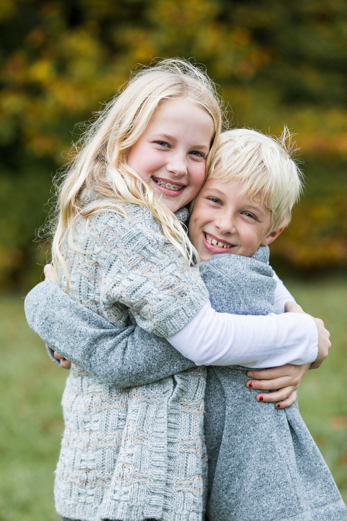 Brother-sister-smiling-for-portraits